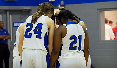 bball team praying | Westminster